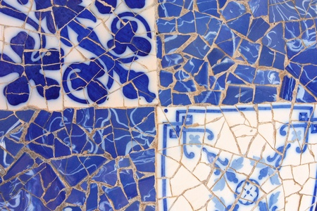 trencadi: Blue mosaic in Antoni Gaudis Park Guell - Barcelona detail. Artistic background texture of trencadis. Stock Photo