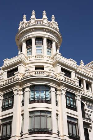 Old ornamental building at Gran Via in Madrid, Spain photo
