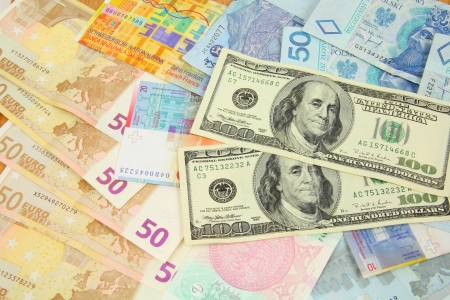 foreign currency: World finance and foreign currency exchange concept - money background with US dollars, Swiss franks, Polish zloty, Euros and Malaysian ringgit. Stock Photo
