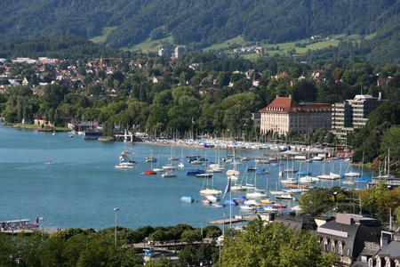 Zurich cityscape with old landmarks and Lake Zurich marina. Summertime Swiss panorama. photo