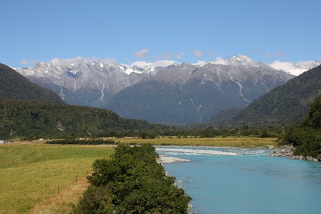 australasia: Summer in New Zealand. Whataroa River and Southern Alps mountain range. Stock Photo