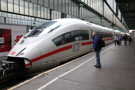 STUTTGART - JULY 24: Intercity Express (ICE) train of Deutsche Bahn on July 24, 2010 in Stuttgart, Germany. DB took over Arriva Plc company in August 2010. ICE 3 class train manufactured by Siemens.