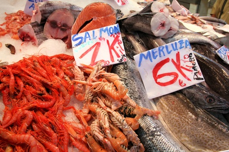 hake: Salmon, shrimps and hake fish at a food market in Valencia, Spain Stock Photo