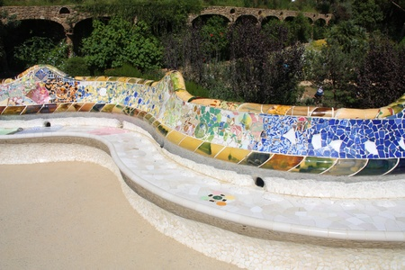trencadi: Artistic mosaic bench in Antoni Gaudis Park Guell - Barcelona detail.