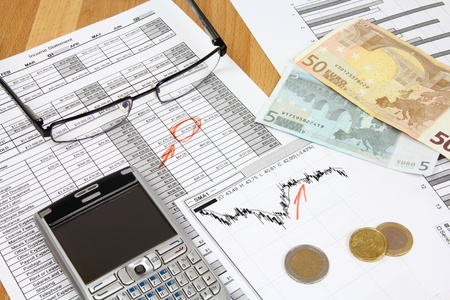 Business composition. Financial analysis - income statement, finance graphs, generic smart phone, Euro money and a fountain pen. Stock Photo - 9108135
