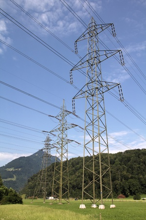 High voltage electricity pylons in Switzerland. Power grid. Stock Photo - 9159868