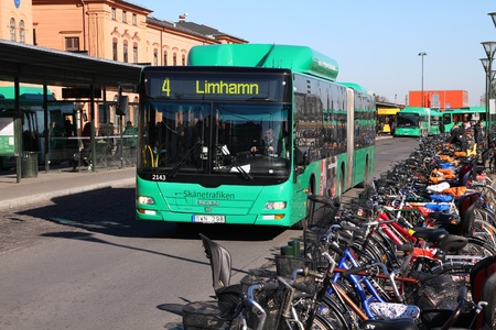 friendly competition: MALMO - MARCH 8: MAN bus and bicycles on March 8, 2011 in Malmo, Sweden. In 2009 MAN delivered 6,232 buses to customers. Cycling is major competition for public transport in Malmo, which is a bicycle friendly city.