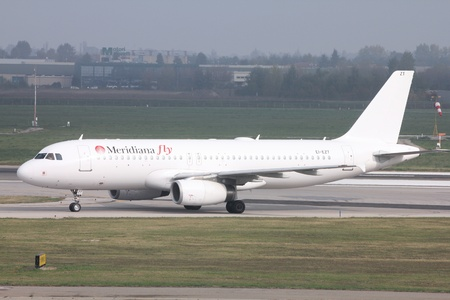 BOLOGNA - OCTOBER 16: Airbus A320 of Meridiana Fly on October 16, 2010 at Bologna International Airport. Meridiana Fly was created in 2010 after merger of Meridiana and Eurofly. Stock Photo - 9232118