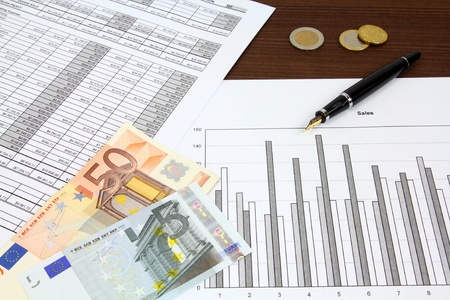 Business composition. Financial analysis - income statement, ink pen and Euro money. Stock Photo - 9281631