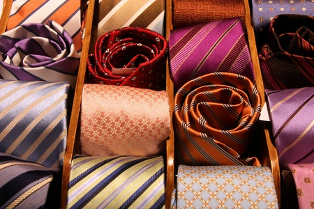 formal dressing: Shopping for elegant dressing accessories. Colorful ties at a shop in Italy. Formal wear selection in a store.
