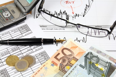Business composition. Financial analysis - income statement, finance graphs, generic phone, Euro money and a fountain pen. Stock Photo - 9410942