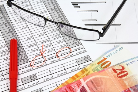 Business composition. Market analysis - income statement, finance graphs, Swiss frank money and a red pen. Stock Photo - 9410932
