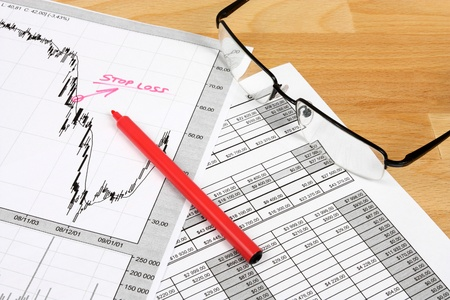Financial planning - business composition with finance charts, stock market graph analysis and glasses. Stock Photo - 9410913