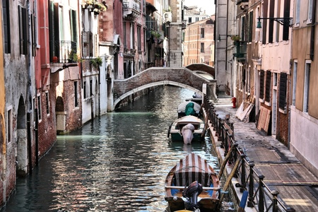 Venice, Italy - boats and old architecture with typical water canal