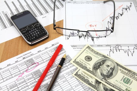 Business composition. Financial analysis - income statement, ink pen and US dollars money. Stock Photo - 9578299