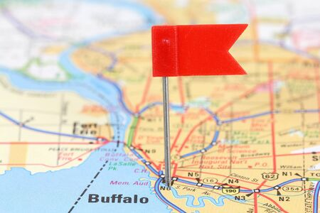 Buffalo, New York. Red flag pin on an old map showing travel destination. photo