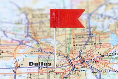 Dallas, Texas. Red flag pin on an old map showing travel destination. photo