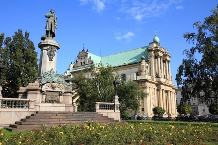 Warsaw, capital city of Poland. Monument of Adam Mickiewicz, the most famous Polish poet. photo