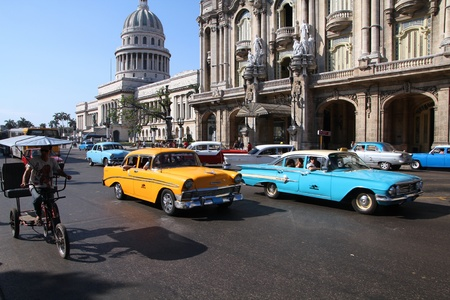 multitude: HAVANA - FEBRUARY 27: Classic American cars in the street on February 27, 2011 in Havana, Cuba. The multitude of oldtimer cars in Cuba is its major tourism attraction.