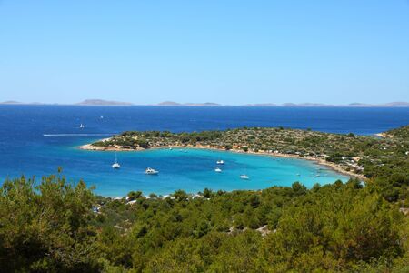 murter: Croatia - beautiful Mediterranean coast landscape in Dalmatia. Murter island beach, Kosirina peninsula - Adriatic Sea. Kornati islands in background. Stock Photo