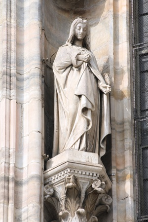 martyr: Saint Marciana the martyr. One of statues in the Cathedral of Milan (Italy). Stock Photo