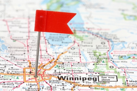 Winnipeg in Manitoba, Canada. Red flag pin on an old map showing travel destination.