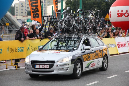 prestigious: KATOWICE, POLAND - AUGUST 2: Team vehicle on the route of Tour de Pologne bicycle race on August 2, 2011 in Katowice, Poland. TdP is part of prestigious UCI World Tour. Peugeot 508 of Vacansoleil-DCM Pro Cycling Team.