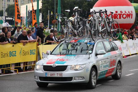 prestigious: KATOWICE, POLAND - AUGUST 2: Team vehicle on the route of Tour de Pologne bicycle race on August 2, 2011 in Katowice, Poland. TdP is part of prestigious UCI World Tour. Skoda Superb of Omega Pharma-Lotto team.