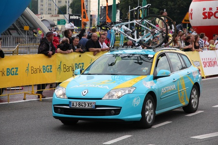 prestigious: KATOWICE, POLAND - AUGUST 2: Team vehicle on the route of Tour de Pologne bicycle race on August 2, 2011 in Katowice, Poland. TdP is part of prestigious UCI World Tour. Renault Laguna of Pro Team Astana. Editorial