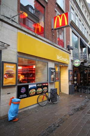 famous industries: COPENHAGEN - MARCH 10: McDonalds restaurant on March 10, 2011 in Copenhagen, Denmark. With 4.9bn USD announced net income (2010) it is the top fast food chain worldwide. Editorial