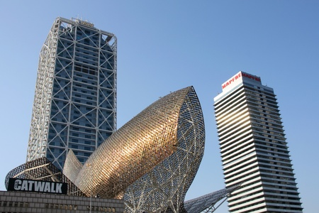 highriser: BARCELONA, SPAIN - SEPTEMBER 10: Skyscrapers and Fish canopy on September 10, 2009 in Barcelona, Spain. Iconic Fish was designed by famous Frank Gehry studio.