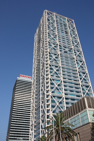highriser: BARCELONA, SPAIN - SEPTEMBER 10: Skyscrapers view on September 10, 2009 in Barcelona, Spain. Iconic duo: Hotel Arts and Torre Mapfre are the tallest skyscrapers in Barcelona. Editorial