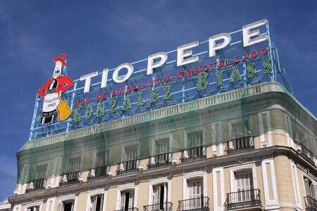 pepe: MADRID, SPAIN - SEPTEMBER 2: Tio Pepe advertisement on September 2, 2009 in Madrid, Spain. The famous neon is recognizable in the cityscape of Puerta del Sol area in Madrid.