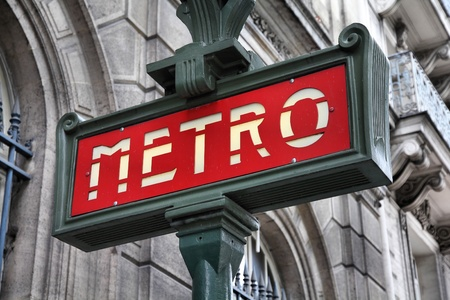 Paris, France - retro metro station sign. Subway train entrance. photo