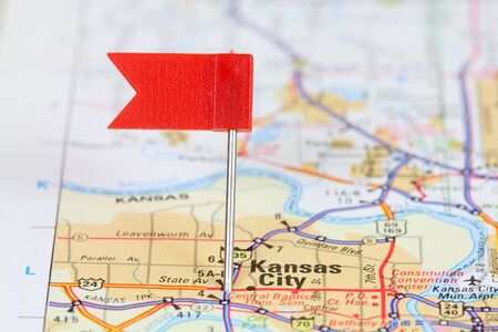 Kansas City, Missouri. Red flag pin on an old map showing travel destination. photo