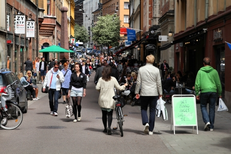 commerce: STOCKHOLM - JUNE 1: Shopping street in Norrmalm district on June 1, 2010 in Stockholm, Sweden. Stockholm is a top shopping destination in Scandinavia.