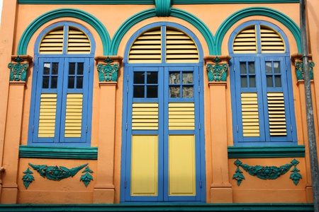 colonial: Closed colorful window shutters in Chinatown district of Singapore, Asia Stock Photo