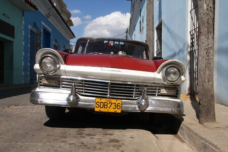 SANCTI SPIRITUS, CUBA - FEBRUARY 6: Classic American car in the street on February 6, 2011 in Sancti Spiritus, Cuba. The multitude of oldtimer cars in Cuba is its major tourism attraction.