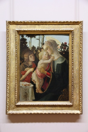 PARIS - JULY 22: Sandro Botticelli painting Madonna and Child with St John the Baptist on July 22, 2011 in Louvre Museum, Paris, France. With 8,5m annual visitors, Louvre is consistently the most visited museum worldwide.