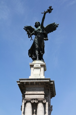 Rome, Italy. One of the statues at famous Ponte Vittorio Emanuele II. photo
