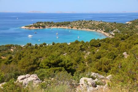 dalmatia: Croatia - beautiful Mediterranean coast landscape in Dalmatia. Murter island beach, Kosirina peninsula - Adriatic Sea. Kornati islands in background. Stock Photo