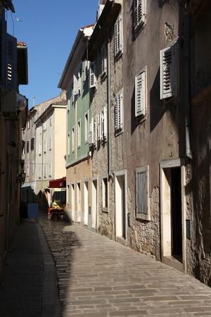 Croatia - Porec on Istria peninsula. Old town cobbled street. photo
