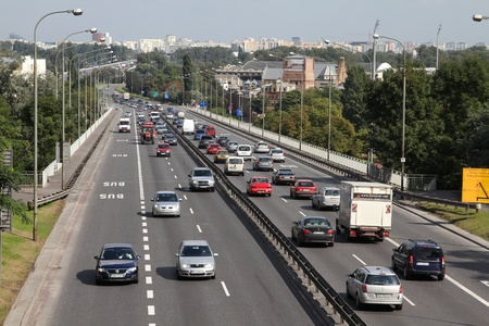 polluting: WARSAW - SEPTEMBER 8: Heavy street traffic on September 8, 2010 in Warsaw, Poland. European road E30 (national road 2) is one of most important traffic arteries in Warsaw. Editorial