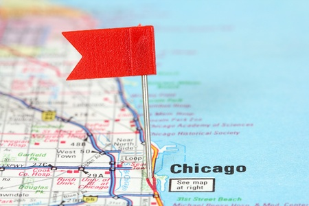Chicago, Illinois. Red flag pin on an old map showing travel destination. photo