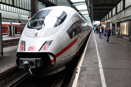 high speed train: STUTTGART, GERMANY - JULY 24: Intercity Express (ICE) train of Deutsche Bahn on July 24, 2010 in Stuttgart, Germany. DB took over Arriva Plc company in August 2010. ICE 3 class train manufactured by Siemens.