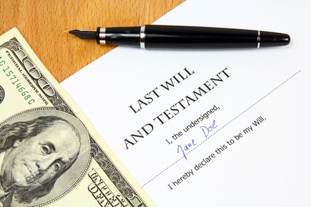 signed: Last Will and Testament with a fictitious name and signature. Document, US dollar money and fountain pen. Stock Photo
