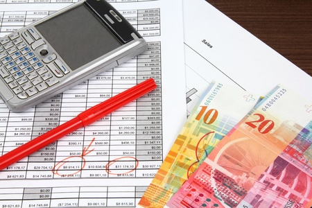 Business objects. Financial analysis - income statement, finance graphs, generic smart phone and Swiss franc currency. Reklamní fotografie