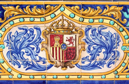 spanish tile: Coat of arms of Spain. Famous ceramic decoration in Plaza de Espana, Sevilla, Spain. Stock Photo