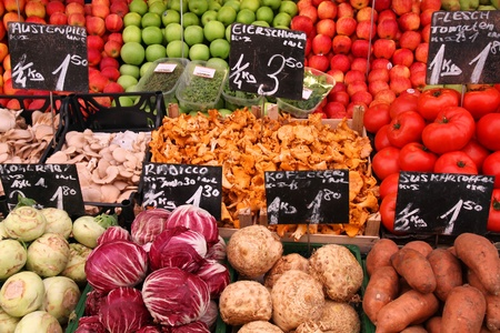 red price tag: Vegetable stand at a marketplace in Vienna, Austria. Farmers market.