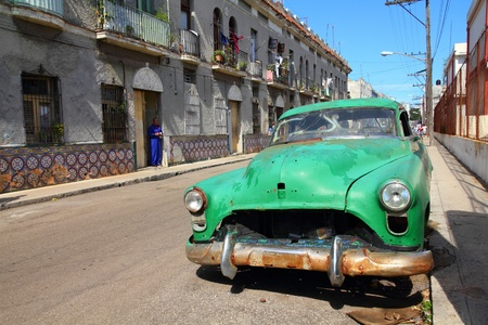 HAVANA - JANUARY 30: Classic American car in the street on January 30, 2011 in Havana, Cuba. The multitude of oldtimer cars in Cuba is its major tourism attraction.